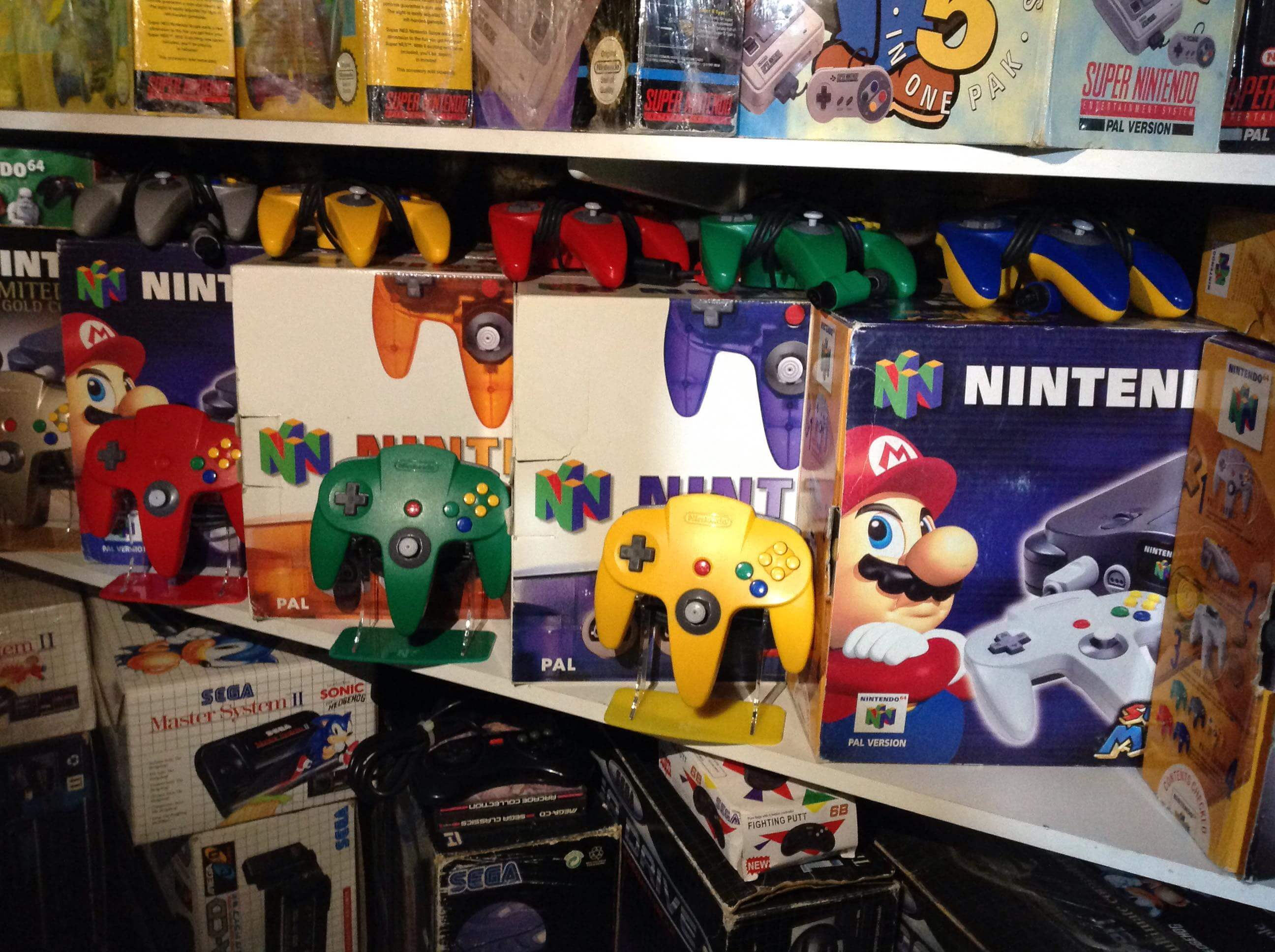Customers N64 Retro Collection of Controller and Consoles with Gaming Displays Controller Stands