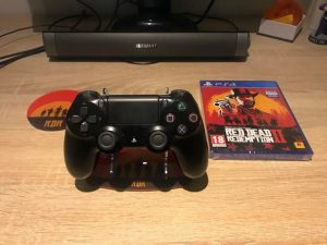 Red Dead Redemption 2 PS4 stand, coaster and game. Competition prize.